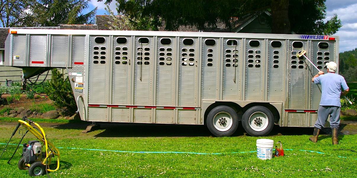 Aluminu trailer pressure washed, now getting a soap scrubbing