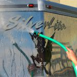 Rinsing the Silver BritePlus MX from the stainless cap of the aluminum horse trailer