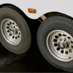 Aluminum wheels on a Hart horse trailer in need of cleaning