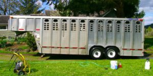 a half cleaned aluminum trailer after cleaning with Silver BritePlus MX